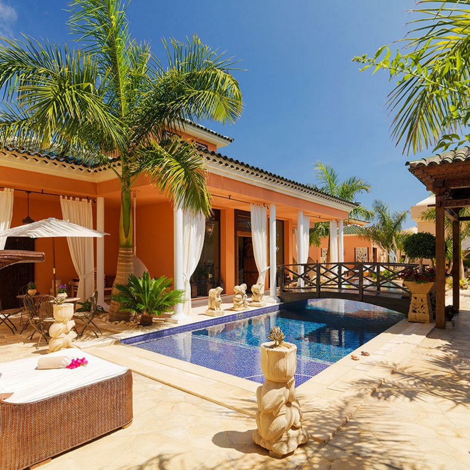 Lounge Luxury Patio Pool Tropical tree building property swimming pool Resort Villa home house condominium mansion hacienda Courtyard backyard eco hotel porch