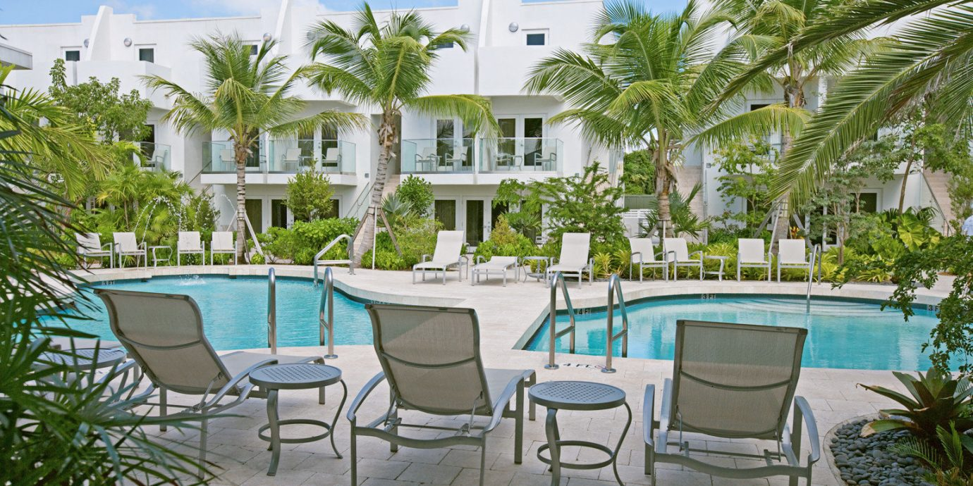 Lounge Patio Pool Terrace Tropical tree chair property Resort condominium Villa caribbean home swimming pool backyard mansion hacienda cottage Courtyard palm set