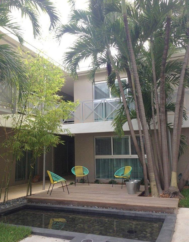 Luxury Pool tree property house condominium home residential area arecales Courtyard Resort Villa yard plant palm