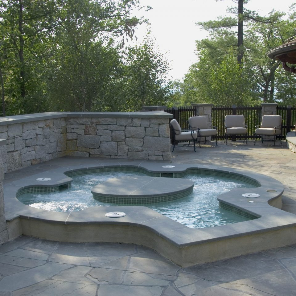 swimming pool water water feature backyard outdoor structure Patio landscape landscaping flagstone yard pond walkway composite material amenity Courtyard