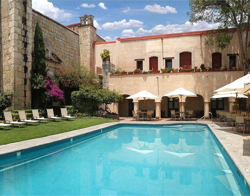 Patio Pool Rustic building swimming pool property Villa mansion Resort hacienda backyard Courtyard