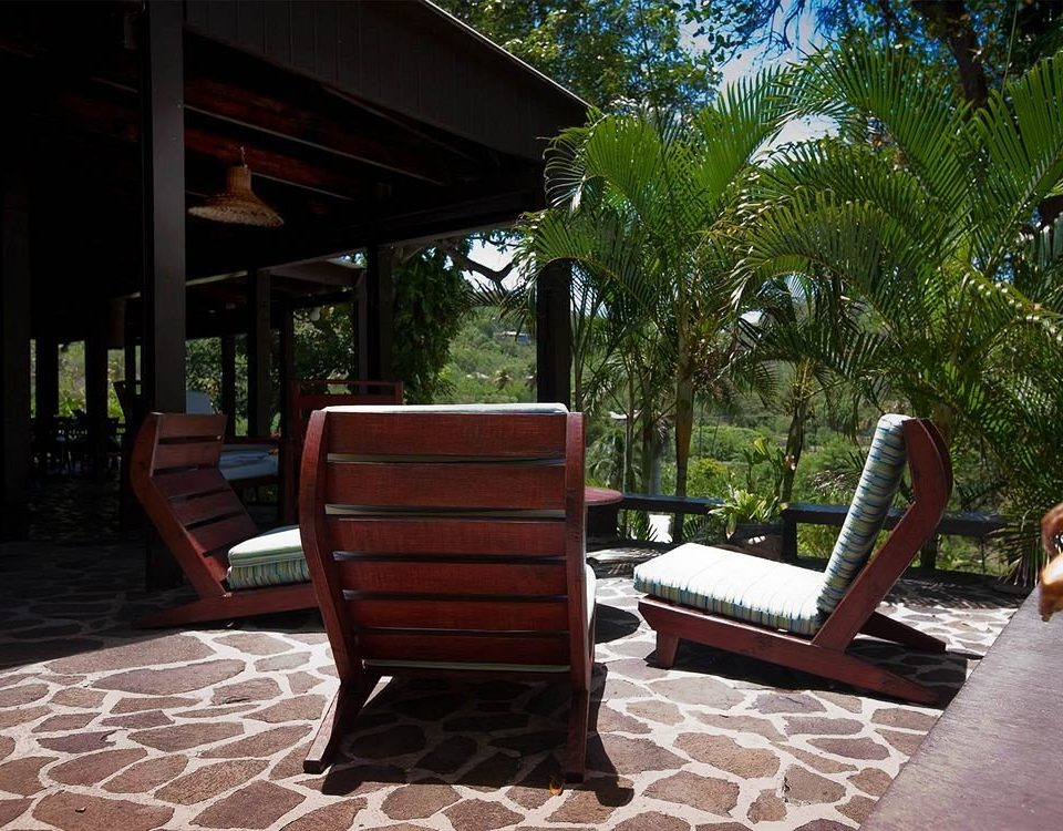 tree property chair porch house home backyard Resort cottage outdoor structure Villa living room Patio park Courtyard hacienda