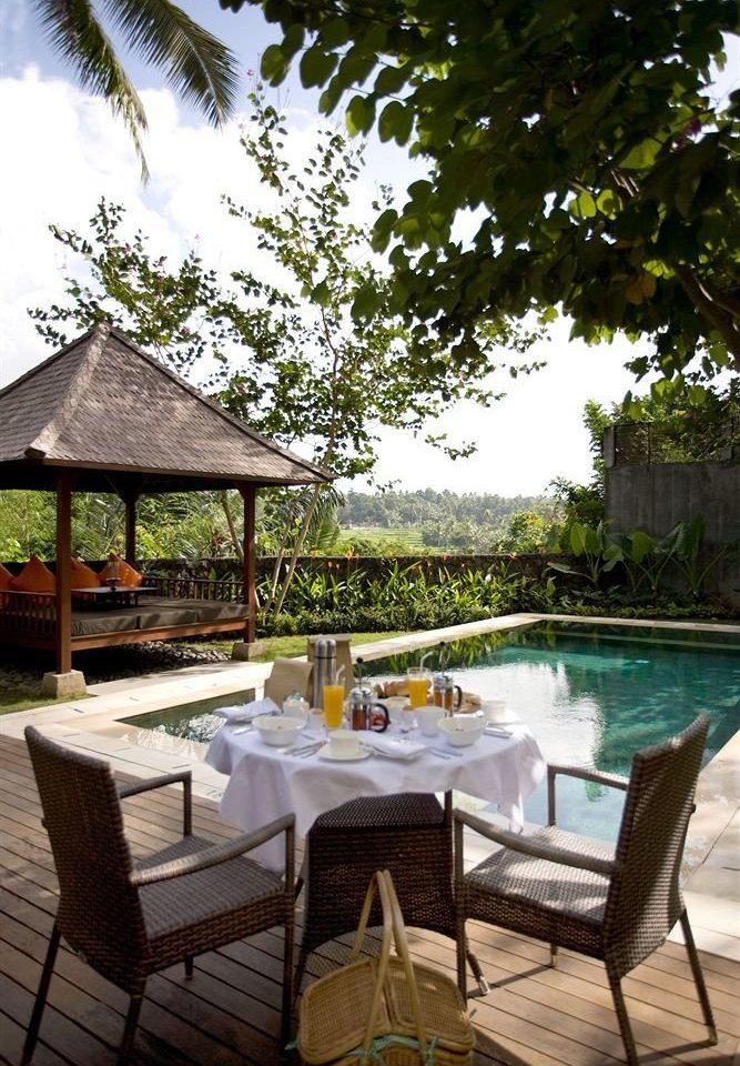 tree property chair backyard swimming pool Villa home outdoor structure Courtyard cottage hacienda Resort Patio set
