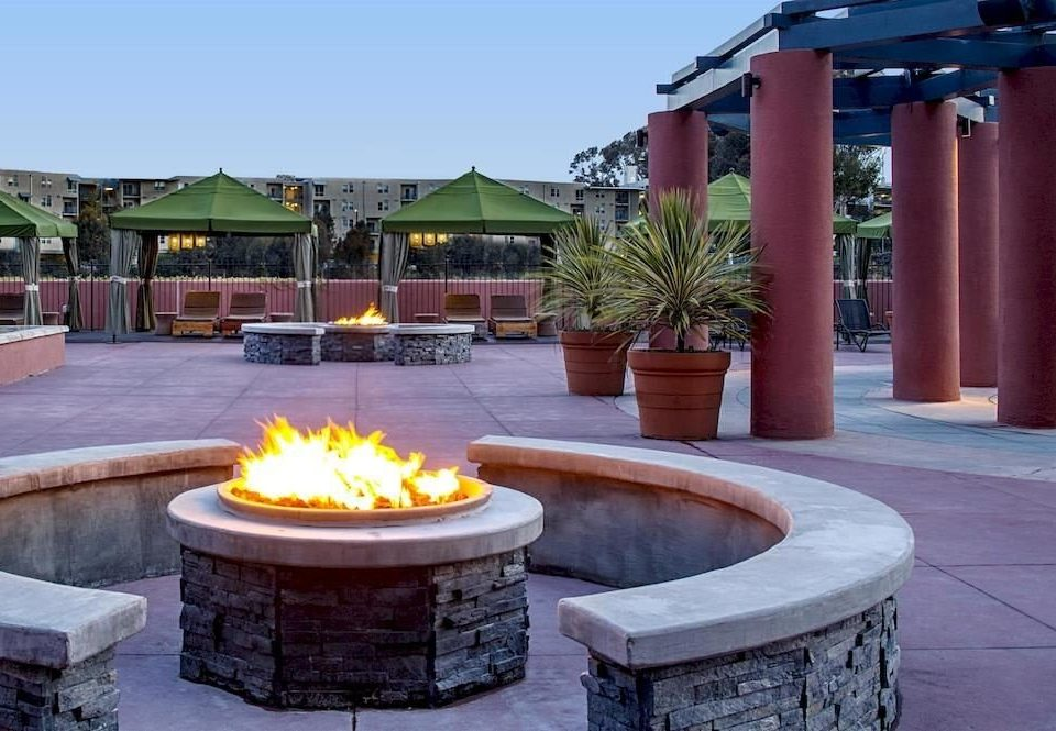 ground backyard swimming pool outdoor structure home Patio Resort Courtyard Villa hacienda orange stone