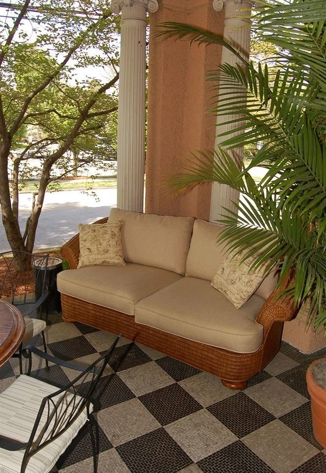 property living room house home porch backyard outdoor structure Villa Courtyard Patio cottage yard sofa seat