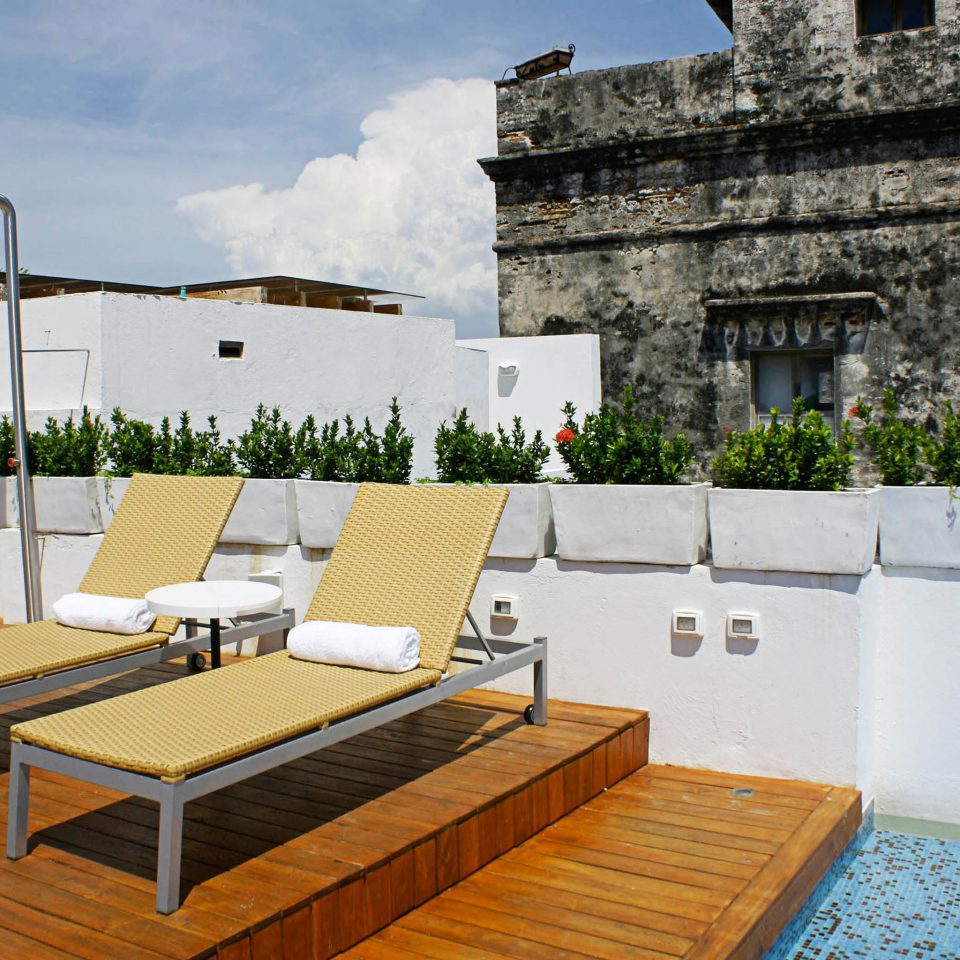 Pool Rooftop property building Villa house condominium Resort mansion Courtyard hacienda outdoor structure