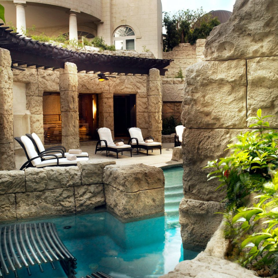 stone rock swimming pool backyard Courtyard Villa Pool hacienda mansion