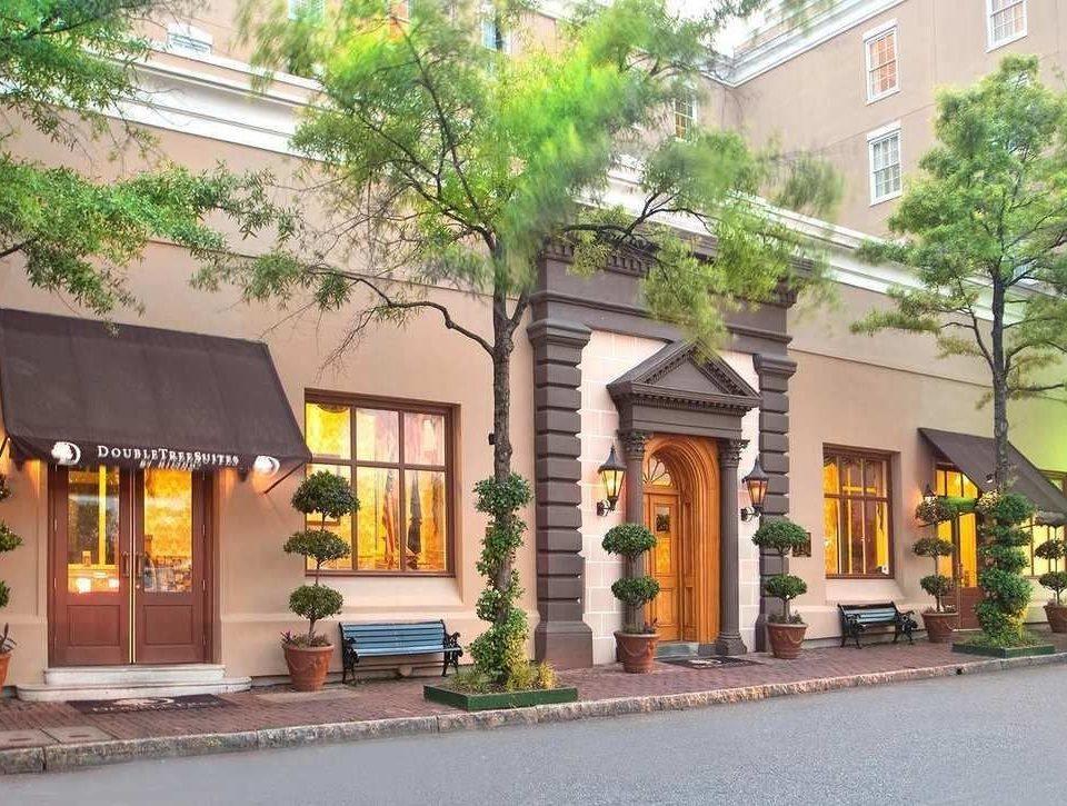 building tree property street neighbourhood home plaza residential area condominium restaurant Resort Courtyard hacienda stone curb