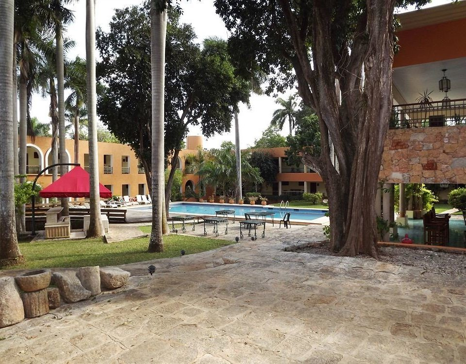 tree ground property neighbourhood Resort home plaza hacienda Courtyard condominium shade