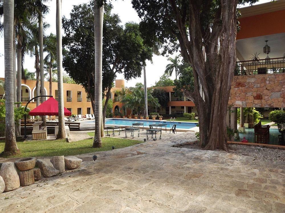tree ground property neighbourhood Resort home plaza hacienda Courtyard condominium shade