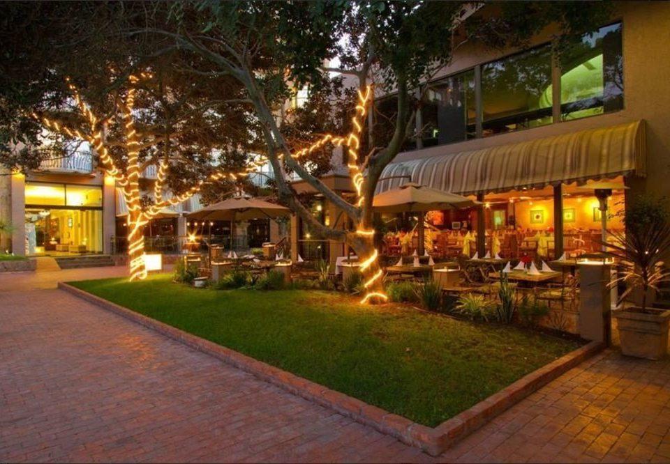 tree property Resort hacienda restaurant night landscape lighting Courtyard way lined
