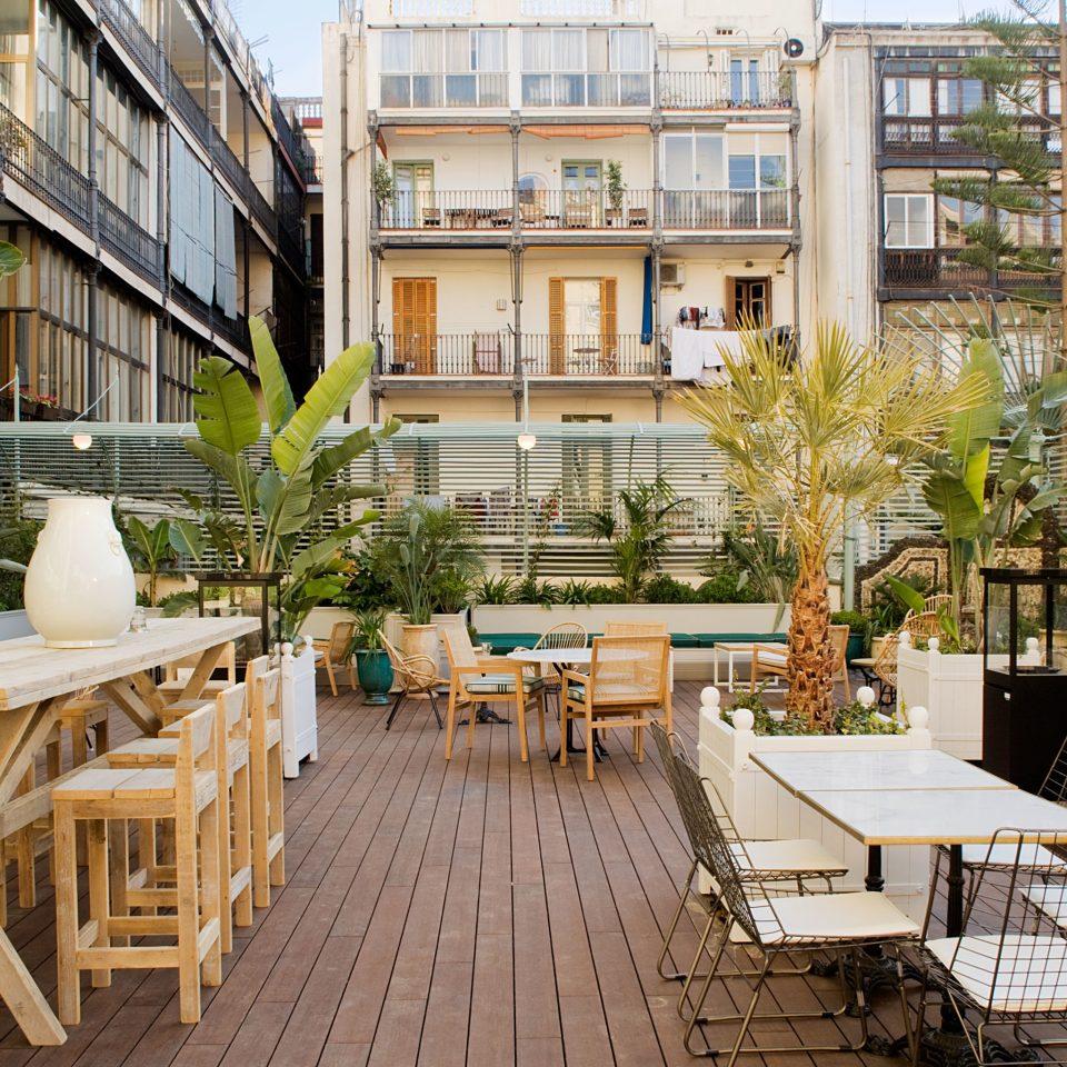 Trip Ideas chair property condominium Courtyard neighbourhood wooden home Resort backyard outdoor structure plaza cottage restaurant