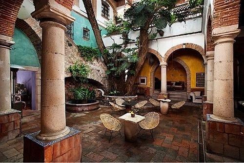 property Courtyard hacienda mansion screenshot ancient history Resort Villa restaurant old arch stone colonnade