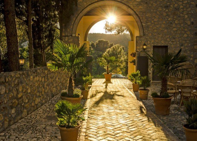 property Courtyard hacienda Villa Resort mansion landscape lighting backyard arch cottage plant stone colonnade