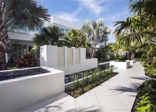 tree property condominium palm home Resort Courtyard arecales Villa walkway residential area swimming pool backyard plant