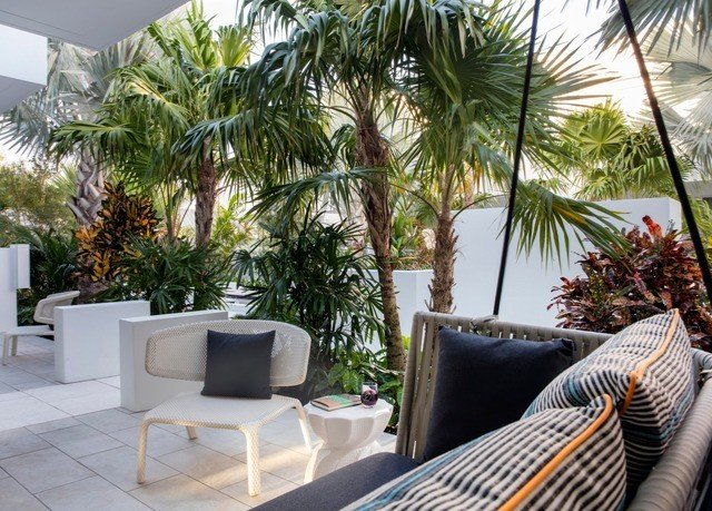 tree property Resort condominium arecales Villa home palm family Courtyard outdoor structure plant palm
