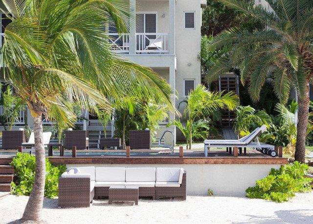 tree property condominium Resort arecales home Courtyard plaza Villa palm family swimming pool palm hacienda restaurant plant