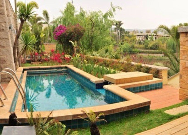 swimming pool property leisure backyard Villa Resort hacienda Courtyard cottage plant eco hotel yard outdoor structure landscaping