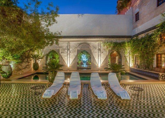 property Courtyard home swimming pool hacienda Villa mansion condominium reflecting pool Resort backyard