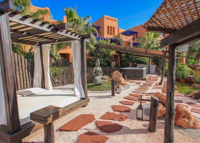 ground property chair Resort Villa home outdoor structure backyard cottage Courtyard hacienda eco hotel condominium