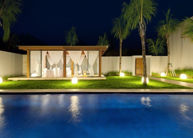 water swimming pool property house Resort mansion Villa home reflecting pool landscape lighting lighting backyard hacienda condominium Courtyard palm plant night