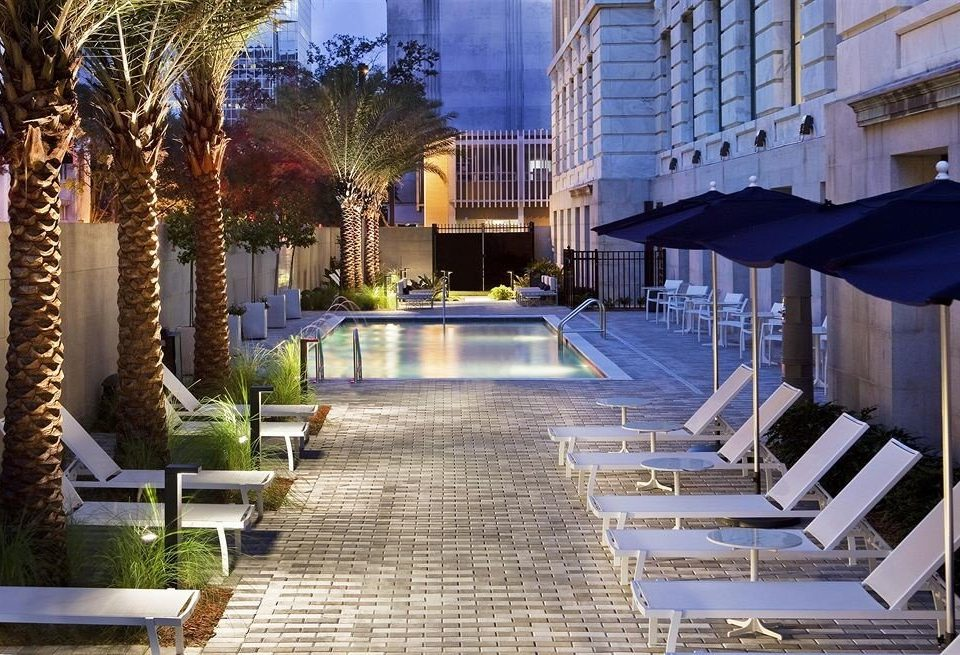 property condominium walkway swimming pool plaza Resort Courtyard home mansion Villa palace backyard