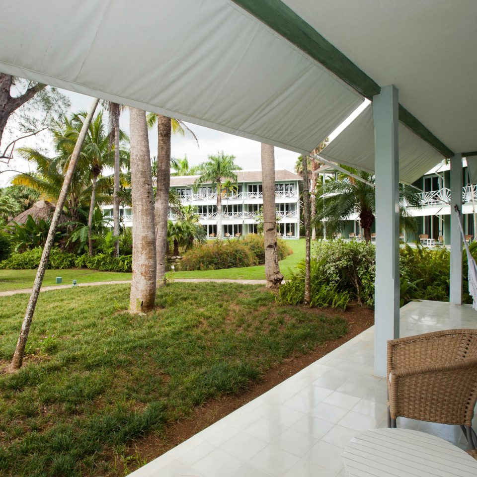 grass property house home Resort Villa backyard porch outdoor structure Courtyard cottage