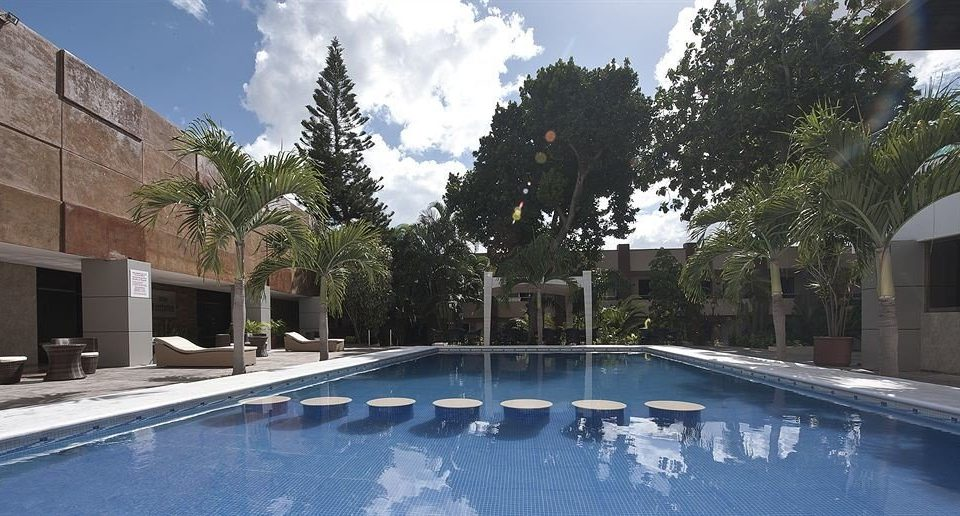 tree building sky swimming pool property reflecting pool condominium Villa bathtub Resort backyard plaza vessel Courtyard