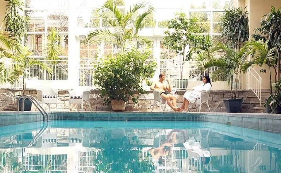 swimming pool property leisure Resort reflecting pool backyard condominium plant Villa mansion Courtyard