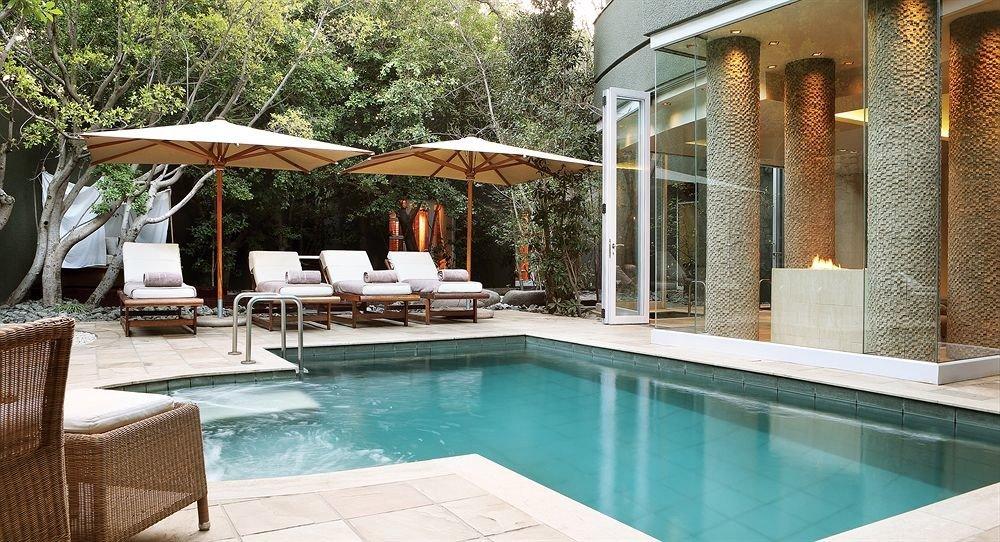 tree swimming pool chair property Villa Resort backyard Courtyard hacienda