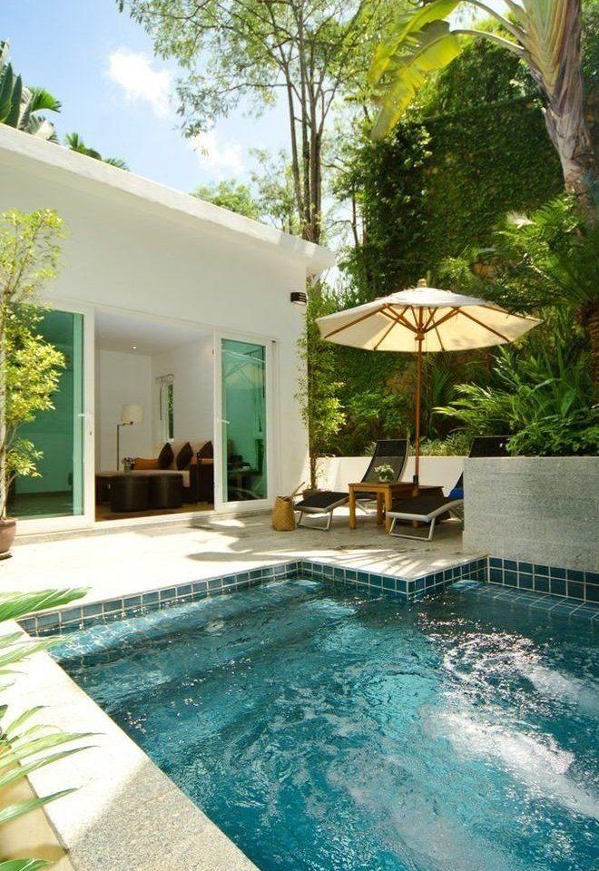 tree swimming pool property Villa backyard Resort condominium home Courtyard mansion cottage day