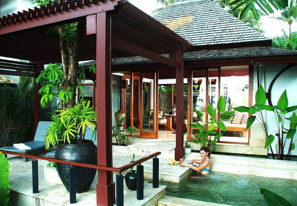chair building Resort porch Courtyard restaurant home backyard outdoor structure Villa eco hotel hacienda cottage