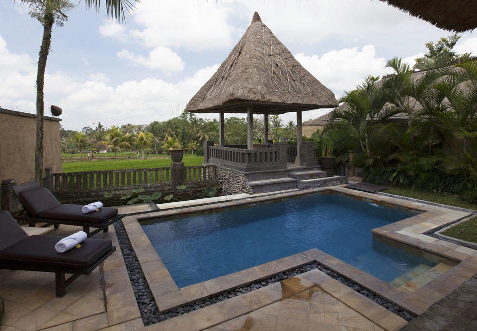 sky tree property swimming pool building Villa backyard Resort cottage hacienda outdoor structure mansion Courtyard