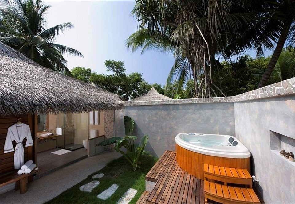 tree property Resort swimming pool Villa house hacienda cottage home palm backyard eco hotel Courtyard mansion stone