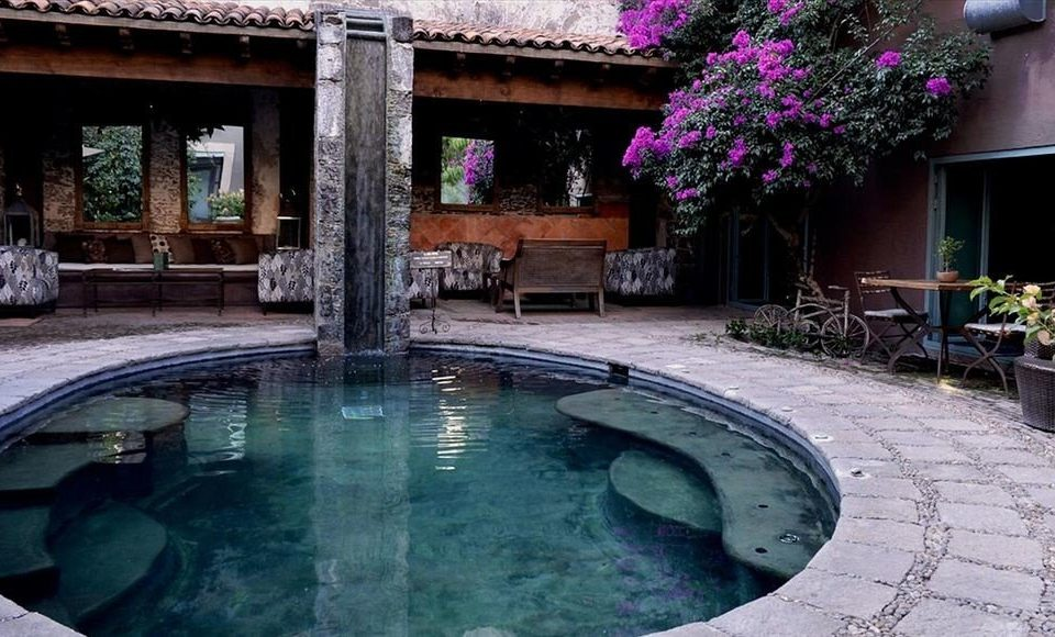 swimming pool property building backyard Courtyard mansion Villa Resort hacienda stone