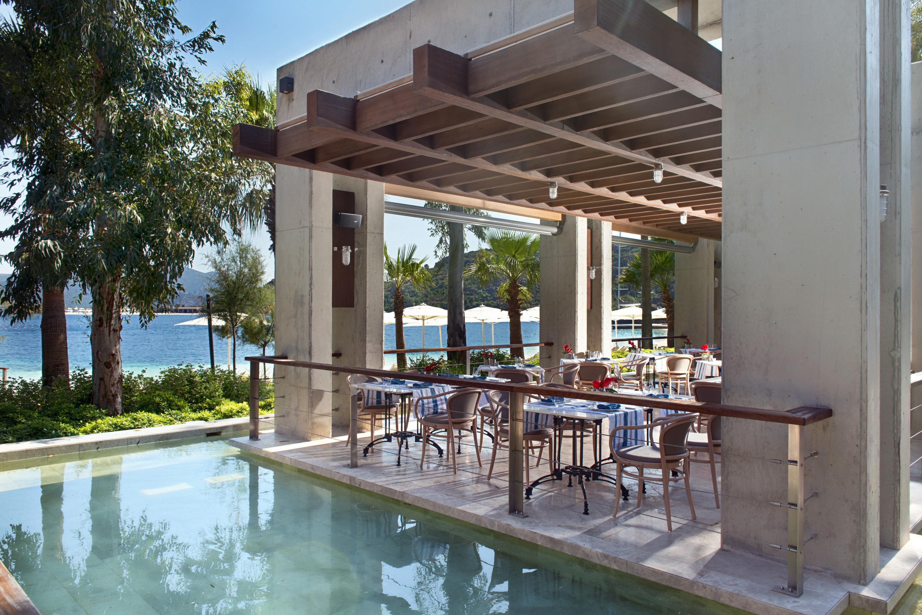 tree building property Villa home outdoor structure condominium backyard swimming pool cottage hacienda Courtyard Resort