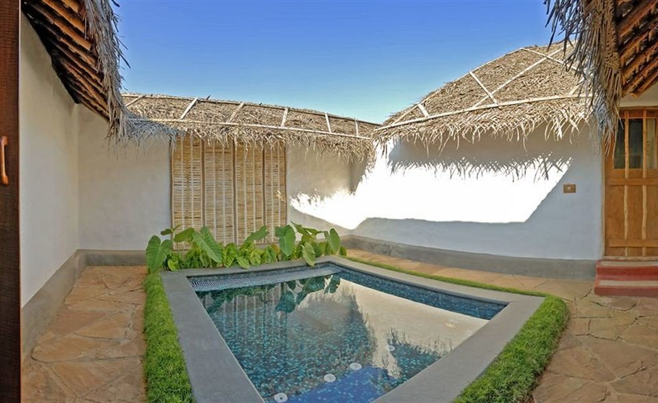 property swimming pool Villa house home cottage Resort hacienda mansion backyard Courtyard