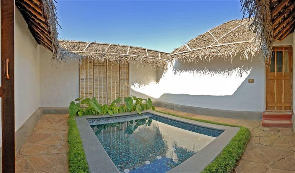 property swimming pool Villa house home cottage Resort hacienda mansion backyard Courtyard