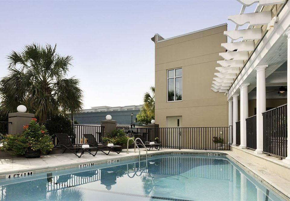 building sky property swimming pool condominium house home Villa Courtyard Resort mansion backyard outdoor structure
