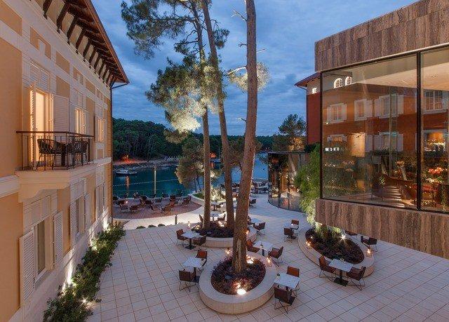 building sky property condominium plaza Resort home mansion Villa Courtyard hacienda porch colonnade