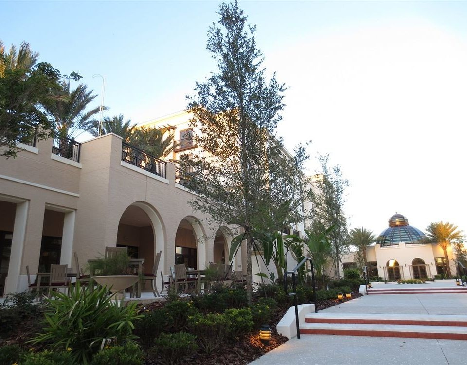tree sky property building plaza hacienda Villa home Resort palace place of worship Courtyard mansion colonnade