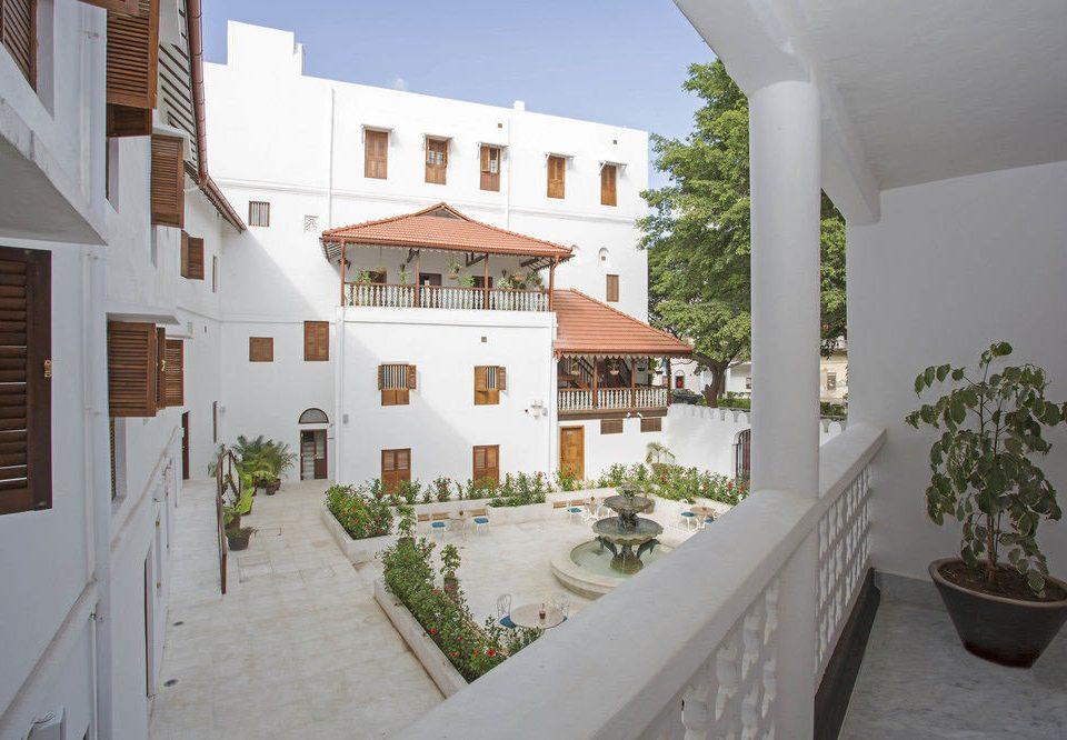 building property house Villa home condominium Courtyard mansion hacienda cottage Resort farmhouse porch