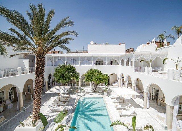 sky property Resort Villa building hacienda mansion home palace condominium Courtyard swimming pool colonnade