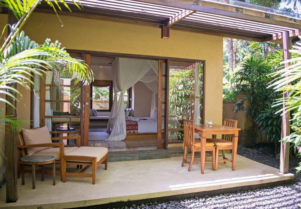 property Villa Resort home porch outdoor structure cottage Courtyard condominium plant