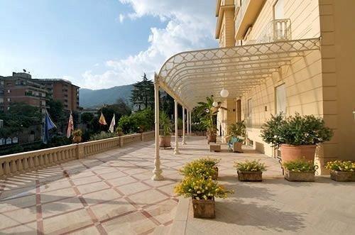 sky ground property plaza condominium Courtyard Resort home Villa hacienda mansion palace walkway stone