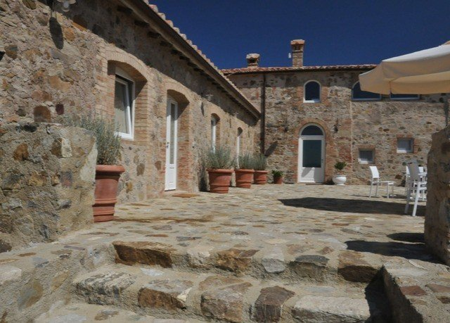 building stone rock ground property historic site brick hacienda mountain place of worship monastery Villa chapel ancient history cottage Courtyard old farmhouse Village Ruins mansion structure