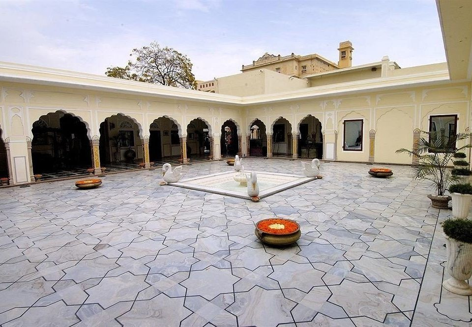 ground property building Courtyard hacienda palace ancient history stone flooring plaza tourist attraction Villa mansion way tile tiled colonnade