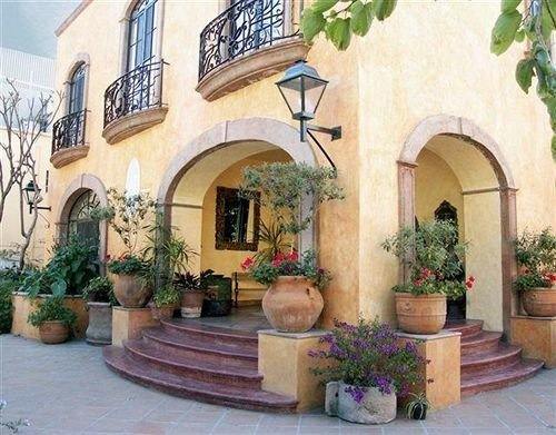 property Courtyard arch hacienda home mansion stone Villa outdoor structure