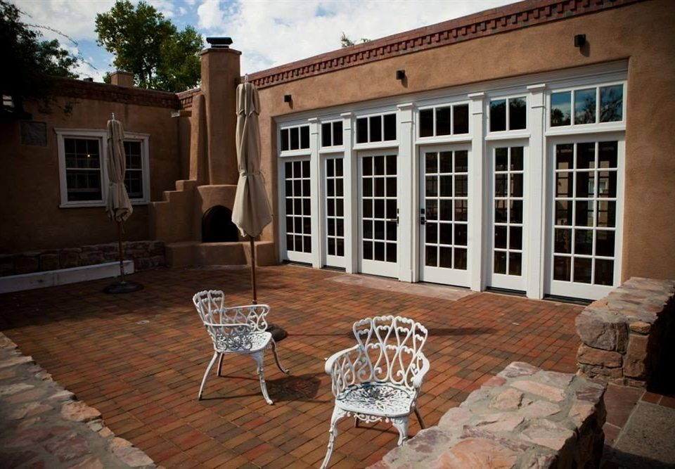 chair property house home Courtyard outdoor structure mansion porch cottage backyard Villa hacienda brick stone