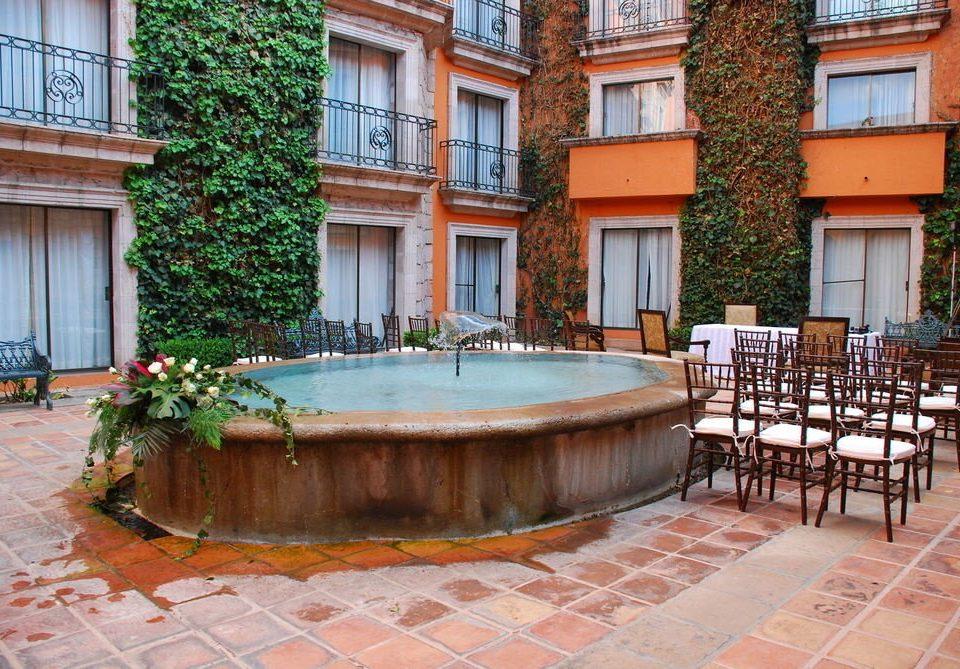 building property swimming pool Courtyard backyard condominium home plaza stone Villa outdoor structure hacienda mansion